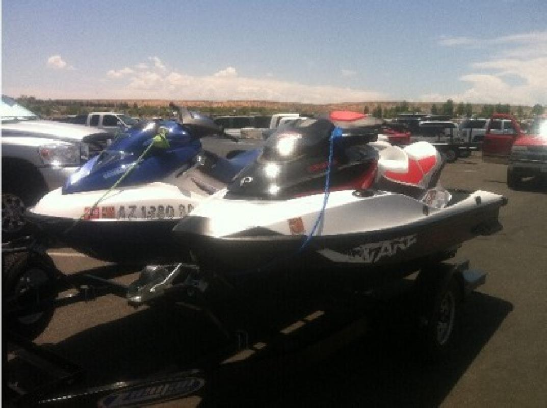 $13,000 2011 Sea Doo Wake Pro 215 and 2002 Bombardier GTX DI