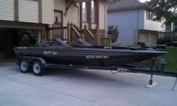 """1998 25th Anniversary Bumble Bee Pro Sport 200 bass boat with a 1998 Yamaha 2-STROKE Series V225TLRW 225HP Fuel Injected motor with less than 250 hours. Maintained at Omaha Marine Center. Winterized and stored on base every year. The boat is 20' 4"""" long"""