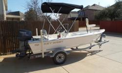Garage kept, excellent condition, Open Fisherman Center Console with YAMAHA 70 HP 2 stroke outboard engine with only 79 hours, on a Karavan float on galvanized trailer, removable 48 qt.cooler seat with cushion, Low profile stainless steel bow rail,