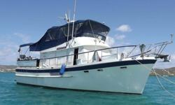 """M/V MoonshineAsk $ 120,000 (a $25,000 DECREASE!)? Manufacturer: DeFever. . . Model: Sundeck. . . Year: 1980? Niad Stabilizers? Length: 43'. . .Beam: 14'6"""". . .Draft: 4'6""""? Hull Material: Fiberglass . . . Displacement (Dry) 42,000. . . Cruise Ready 52,000?"""