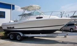 This 24' Wellcraft Walk Around is the nice blend of offshore fishing machine and weekend cruiser, with a very large cockpit for your crew to fight and bring in the catch. The covered helm with hard top, has twin helm seats and great visibility. The