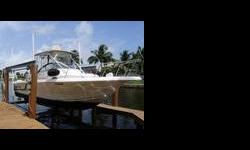 (LOCATION: Marco Island FL) The Pro-Line 231 Walkaround strikes the balance between fisherman and family cruiser. She has a large open cockpit with enclosed helm and all the amenities needed for successful fishing. Below is a comfortable cuddy cabin. The