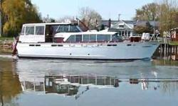 (LOCATION: Detroit MI) This 50' Chris-Craft Constellation is a fresh water time machine with classic features and drop-dead good looks. Sweeping bow, teak decks, wood hull, covered helm, spacious aft deck, and traditional salon make her stand out in any