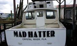 (LOCATION: Crystal River FL) The Hatteras 34 SF is a full-featured sportfisherman designed to combine fishability, comfort, and compact size. The Mad Hatter is a project boat whose renovation has stalled and is ready for a new owner to finish the