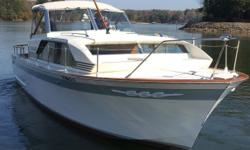 1963/2014 30 ft Chris Craft Connie - Windfall spent it's entire life in the Thousand Islands in either a boat house or inside storage in NY until I had her shipped to Lake Norman.Docked under cover it has twin 283/185 hp. engines. She comes with a