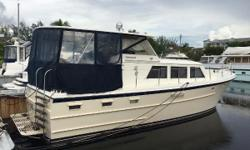 Looking for a great inexpensive live-aboard? Well-built classic boat manufactured in Miami to compete with the Hatteras's of the day. Nicely updated salon and staterooms, and two heads, a stall shower, and a walk in closet! She's a big 39, with tons