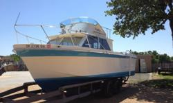 1970 Uniflite Fly Bridge Length 27FT Uniflite Fisherman with Fly Bridge Well taken care of Always in covered slip Excellent condition Twin Engine 318 Chrysler motors Stereo system Twin axle trailer Full boat cover Unit is located in Ketchum OK. Financing
