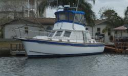 Accommodations AccommodationsForward is the guest stateroom with a V-Berth with ample storage and a large private head with plenty of room to move around. The galley down arrangement includes a Norcold refrigerator and three burner electric stove. The