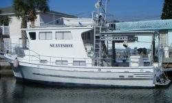 Description (LOCATION: Hudson FL) This 40' Custom Pilothouse is a unique trawler. She is designed to take you anywhere with comfort and economy. Whether you are planning a weekend getaway want to live-aboard or are looking to cruise to the islands this