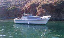 1974 Tollycraft Express 28.5 foot Cabin Cruiser with a fiberglass hull is in great shape. It has twin Chrysler model 318 V8 engines with 225 horsepower, gasoline with 120 gal tank capacity. Garmin depth finder. No anchor wingless.It has a head, kitchen,