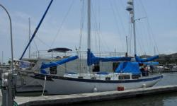 Argonaut has a spacious V-berth forward with a spacious custom tilled head located just aft to port. The main salon can sleep four with a single settee to starboard and a settee to port that converts into bunks that can sleep three. The settees are