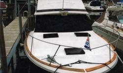 1975 Trojan Yacht F-32 Sedan 1975 Trojan Yacht F-32 Sedan Bridge boat in great condition Equipped with dual MerCruiser Gas motors Fiberglass Hull and Flybridge Sleeps 6 using the Hulls bedroom the Kitchen Dinette table which is designed to transform into
