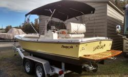 2015 restoration 20 foot center console. This boat is in covered storage. The protected keel drive and the inboard installation of the new Commander Ford 302ci, 225 H.P. makes it note worthy. The new Fighting Lady Yellow paint makes the boat stand out.