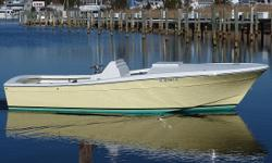 """""""BETTER THAN NEW"""" This is that chance to own a custom INBOARD CENTER CONSOLE, Re-Manufactured, with a no holds approach to quality! """" Newly completed....ZERO, 0 HOURS!! Fighting Lady yellow hull; TOTALLY re-manufactured classic 24 inboard Center"""