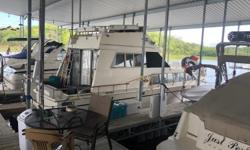 Free slip paid through March 31st 2019. Fun large Carver Cruiser available for immediate ownership! Price includes 34x14 Covered slip on I dock within LPYM harbor. Twin Crusader 350's V Drives, (Generator install on boat but needs work), Air conditioning,