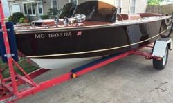This unique boat has a custom wood grain hand painted design throughout the whole boat. For any more information please call us. Nominal Length: 18'
