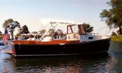 This beautiful, classic 1979 Sisu Downeast 22 is located in Bridgeport, CT and powered by a 75 hp 2008 Yanmar diesel with only 10 engine hours. Designed by Royal Lowell in the style of a Maine lobster boat, Roccus is a real head-turner. She was completely