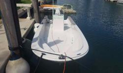 (LOCATION: Coral Gables FL) Dont let the age fool you, this classic Boston Whaler 22 Outrage  center console is ready to fish. Recently rebuilt and repainted she defies her age. The roomy cockpit has forward seating / casting steps with storage,