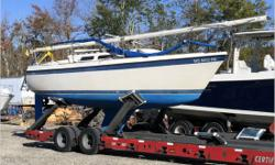Actual Condition It was reported the aft chain plate stainless steel tang broke and resulted in the mast to fall forward on the vessel. The rigging, bow rail, Schaefer roller furling unit, mast step, mast wiring and sails were damaged. Aside of the