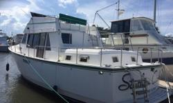 Twin engine trawler. Dual stations. Two staterooms, two heads. THIS GIRL WILL TAKE YOU ANYWHERE YOU WANT TO GO-DO THE LOOP OR HEAD TO THE ISLANDS FOR FUN AND SUN--EAT OFF THE ENGINES-REALLY SEE THE PICS!! GENERATOR=UP AND DOWN HELMS-CENTRAL