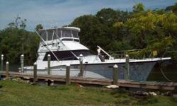(LOCATION: Hernando Beach FL) The Hatteras 46 Convertible is a classic sports fisherman with high foredeck, sweeping sheer line, and low freeboard cockpit. She comes with a spacious flybridge with custom hard top, huge cockpit, teak finished salon,