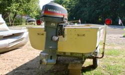 This boat has a Mariner 25hp electric start 2 stroke outboard. It has a shorelander trailer.