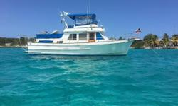 LOOKING FOR A GREAT LOOP CRUISER? This classic Ed Monk Jr designed Ocean Alexander 40 Double Cabin was kept in fresh water up until 2 years ago, and she shows it! No window leaks and clean gelcoat! Offering two staterooms and two heads, the desirable