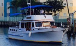 This 1984 / 2015 Marine Trader 43 Sundeck Trawler, The Giuliana,is one of a kind and a real head turner. She looks brand new from the bimini top to the paint on the bottom and from bow to stern. Most everything has been updated or