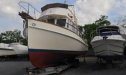 36' Grand Banks Classic Trawler A semi-displacement hull with a long keel, hard chines and a deep forefoot provide the stability that has won her a reputation for seaworthiness unmatched by boats in her class. She is finished with handcrafted teak