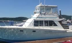 Sleeps 6, has offset double forward, head has marine toilet w/stall shower, dinette down converts to double berth, large galley w/full size refrigerator, nice salon with convertible settee, large cockpit w/custom tuna door Nominal Length: 40' Length