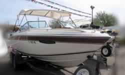 Yes Folks... it's a World Class WELLCRAFT! This quality built 210 Elite cuddy is powered by a 5.7ltr 260 Mercruiser, cruises at 45mph with excellent compression, loaded with lots of teak accents, has a bimini and much more. Come check out this classic