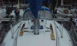 """Specifications: Name: Gulls Way LOA: 31' 4"""" Beam: 10'11 Draft: 4' 4 Model Year: 1985 Model: 31 cruising mono-hull Hull Material: Fiberglass LWL: 26'3 Bridge Clearance: 47'4 Hull Color: white Interior: Stained teak, brown cushions, green marble Formica"""