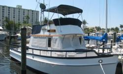AccommodationsAccommodationsEnter this beautiful classic layout down 1 step from side doors - port to salon or starboard to lower helm or aft door down 4 steps to master. Salon has lovely teak wood throughout and parquet sole and navy cushions in very