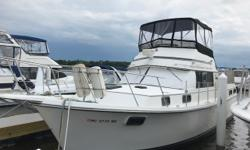 Great live aboard two stateroom boat with plenty of room to sleep 8. New canvas enclosure on the bridge. The modified V-Hull is designed to be efficient as a trawler but able to plane at higher speeds. Make an appointment to see today! Trades considered.