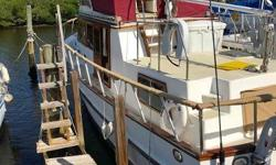 (LOCATION: Port Richey FL) This Monk 36 Double Cabin Trawler is a comfortable motor yacht designed for casual coastal cruising.  She comes with flybridge with bimini top, full enclosure, sundeck, walk around main deck, roomy salon, full galley, and