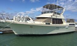 Treat yourself to old world craftsmanship with luxurious woodwork throughout the entire boat. This boat features a spacious salon, full sized kitchen and large staterooms. Relax. Trades considered. CANVAS BIMINI TOP (TAN) SIDE/AFT CURTAINS DECK ANCHOR