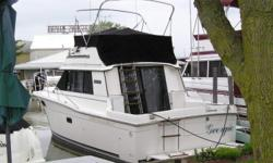 Same owner for the past 19 years, new stringers in 2002. Beam: 11 ft. 7 in. Compass; Depth fish finder; Stove; Boat cover; Vhf radio; Stereo; Bimini top; Shore power; Gps loran; Fridge; Shower; Swim platform;
