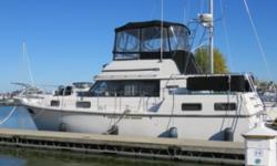 Trades considered.CANVAS BRIDGE ENCLOSURE WINDSHIELD PRIVACY SCREEN DECK ANCHOR W/LINES BOW PULPIT W/RAIL FENDERS & LINES RADAR ARCH SPOTLIGHT WINDSHIELD WIPERS ELECTRICAL 12 VOLT SYSTEM 30 AMP DOCKSIDE POWER 50 AMP DOCKSIDE POWER BATTERY (3) BATTERY