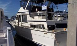 Powered by Twin Detroit 671TAB Diesels, the workhorse of the marine industry, 410hp each, MASE 12.3kW generator, Spacious 3 stateroom layout with full deep walk-around gunnels. Upper and Lower Helms with Complete Garmin Electronics GPS/Chart/Radar/Depth,