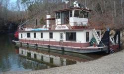 1986 Tucker Marine Stern Wheeler / Paddle Wheeler - 84x20.5 The Columbia is a 1986 tow boat built by Tucker Marine. She was built by Mr. Tucker as a liveaboard for himself, and she was built to commercial standards. The only wood in the boat