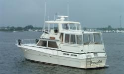 1987-2003 Freshwater Great Lakes Boat Twin Hardtops with EZ2CY enclosures. Bottom stripped and barrier coated. Boat striping/detail Black. Aft deck with new teak furniture and wet bar. Aft spreader lights, reconditioned/rechromed windlass, remote spot