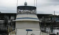 1987 PT Trawler Sedan GENERAL EQUIPMENT.- Anchor with Chain Anchor Chest Boarding Ladder Swim Platform Color TVs (2) Davits Deck Hatch Pressurized Water System Pulpit Radios (2) Transom Door Satellite Dome Electric Oil Change! COVER TYPE.- Flybridge with