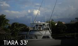 Actual Location: Port St Lucie, FL - Stock #074464 - Professionally Repowered! Turn Key and fish Big!This Tiara 3300 Flybridge is a good looking vessel with a huge cockpit which is approx. 11X 10 according to the seller. Her rakish profile and glassed-in