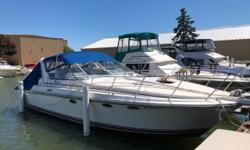 Well-built express with a 14-foot beam. With low hours and looking well-maintained and stylish for its time, this is a solid riding boat. Please call to arrange a showing. Trades considered. CANVAS SIDE/AFT CURTAINS (BLUE) DECK ANCHOR W/LINES BACK ARCH