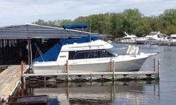 1988 Carver Yachts Voyager 2827 Well maintained boat Lots of classy attributes Teak wood and newer upholstery Canvas cover Extra set of propellers 1045 hours Length 28FT AM FM radio Anchor Generator Head VHF radio Stove and sink Shower Swim ladder and