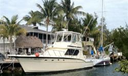 (LOCATION: Summerland Key FL) The Hatteras 45 Convertible is a classic sports fisherman with high foredeck, sweeping sheer line, and low free board cockpit. Solid construction and good handling made the Hatteras 45 a tournament favorite. She comes with a