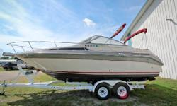 This used 1988 Sea Ray 25 Sorrento is in great shape and ready for the whole family! Features include hour meter, 4-blade propeller, trailer, manual pump out head, convertible top, side curtains, aft curtain, camper top, cockpit cover, compass,