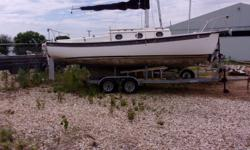 Nice Daysailer! New Rudder/Tiller. Includes Porta Potty-Battery-6 gallon fuel tank- Electric Start 8hp Suzuki 2-stroke engine. Main sail 3yr old ( includes original main-needs work), Jib is also in good condition. Pictures coming soon. Call for more