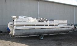 Well Kept Older Pontoon. Late model 2013 Evinrude e-tec and a Genesis trailer. Engine checked out and boat is water ready. Large deck and w/Coast Guard persons capacity at 15. SEE MORE PICTURES OF THIS AND OTHER NEW AND PRE OWNED BOATS ON OUR WEBSITE AT