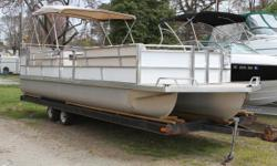 This is an interesting older boat.  It has teak wood finishes and extensive stainless railing mods.  It's a rare, old boat and will most likely be the only one of it's kind on whichever lake you float it on.  It needs a little TLC - some of
